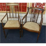 Lot 051 - Two Edwardian inlaid mahogany elbow chairs.