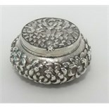 Lot 029 - A Chinese silver pill box, stamped with Chinese character marks, approx 50mm diameter.
