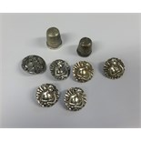 Lot 025 - Six Art Nouveau silver buttons and two silver thimbles (approx 25.8gms).