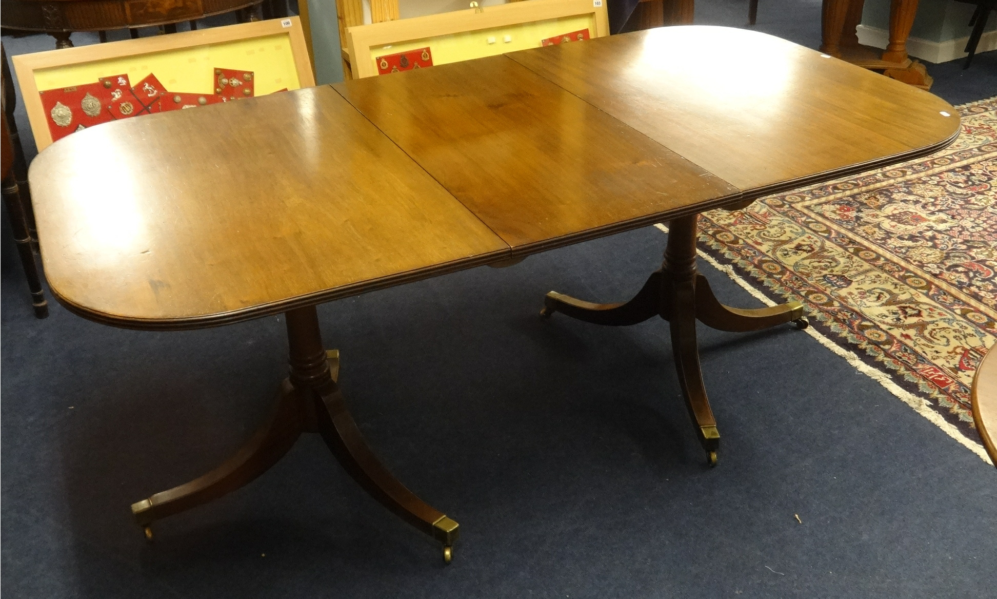 Lot 055 - Mahogany twin pedestal dining table, length 182cm with leaf