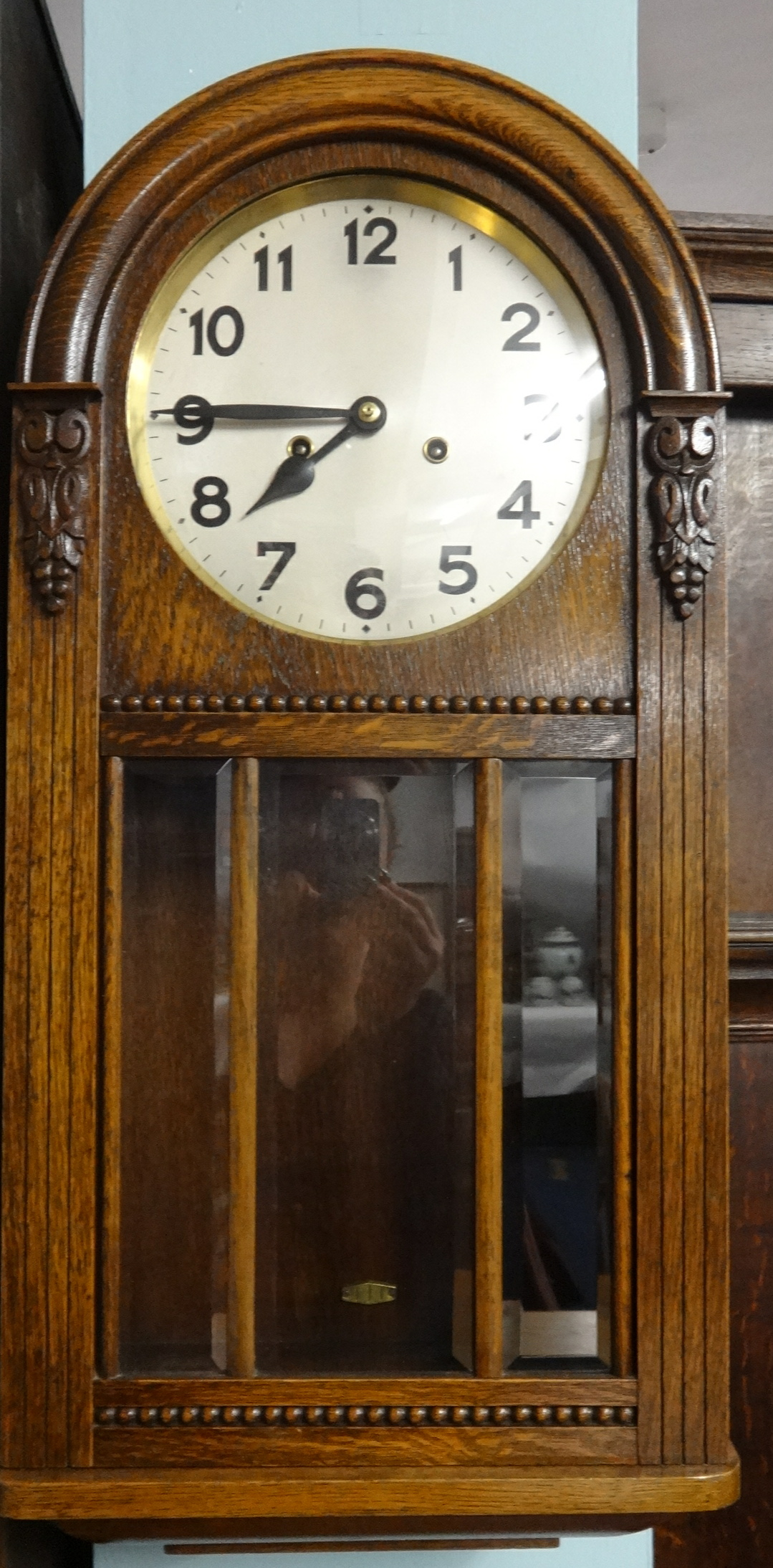 Lot 050 - Early 20th Century oak wall clock with eight day movement.