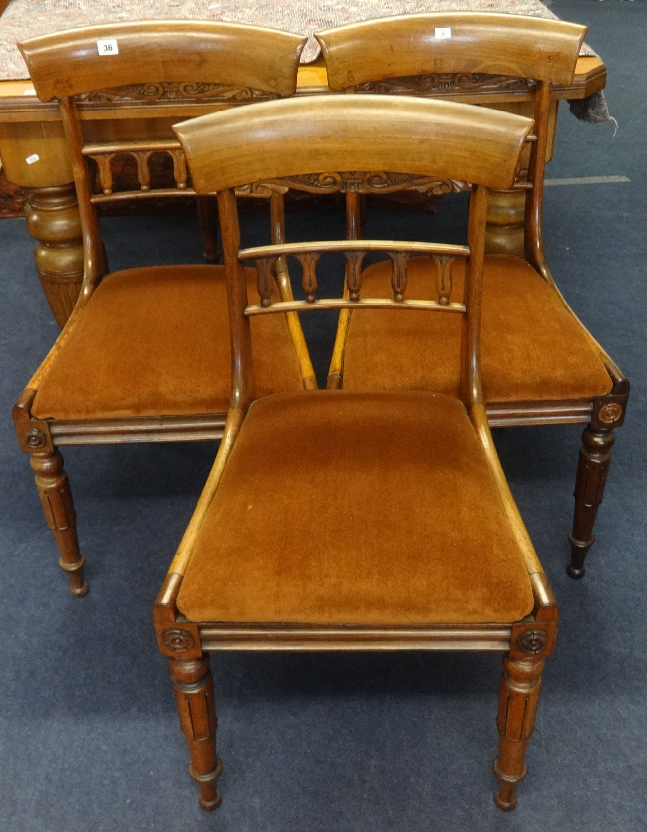 Lot 36 - A set of eight William IV rosewood framed dining chairs, with drop in seats.
