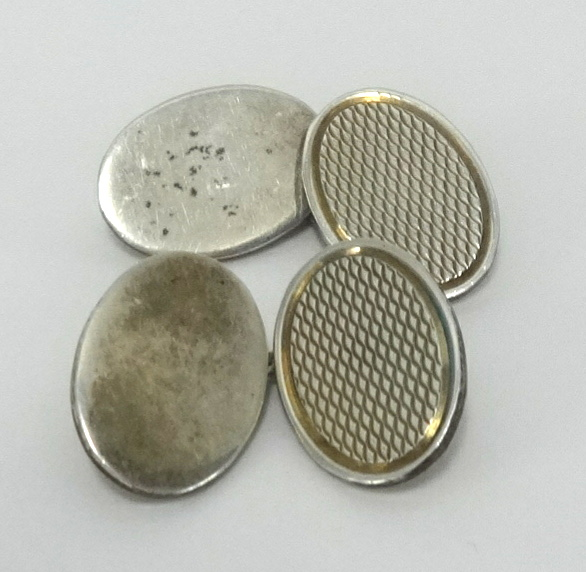 Lot 035 - A pair of silver oval gents cufflinks, approx 12.30gms.
