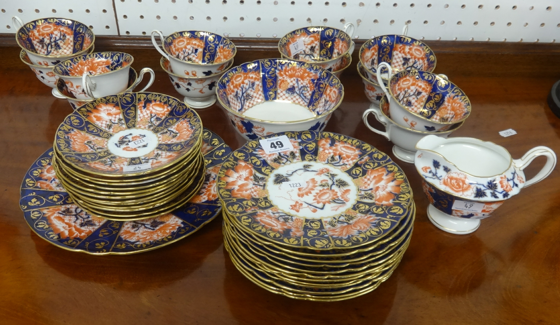 Lot 049 - An early 20th Century Foley china twelve setting porcelain tea service of Imari design.