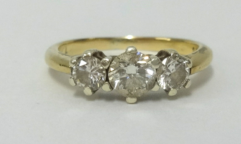 Lot 021 - A 9ct gold and three stone diamond ring, total diamond weight approx 0.76cts together with 2007