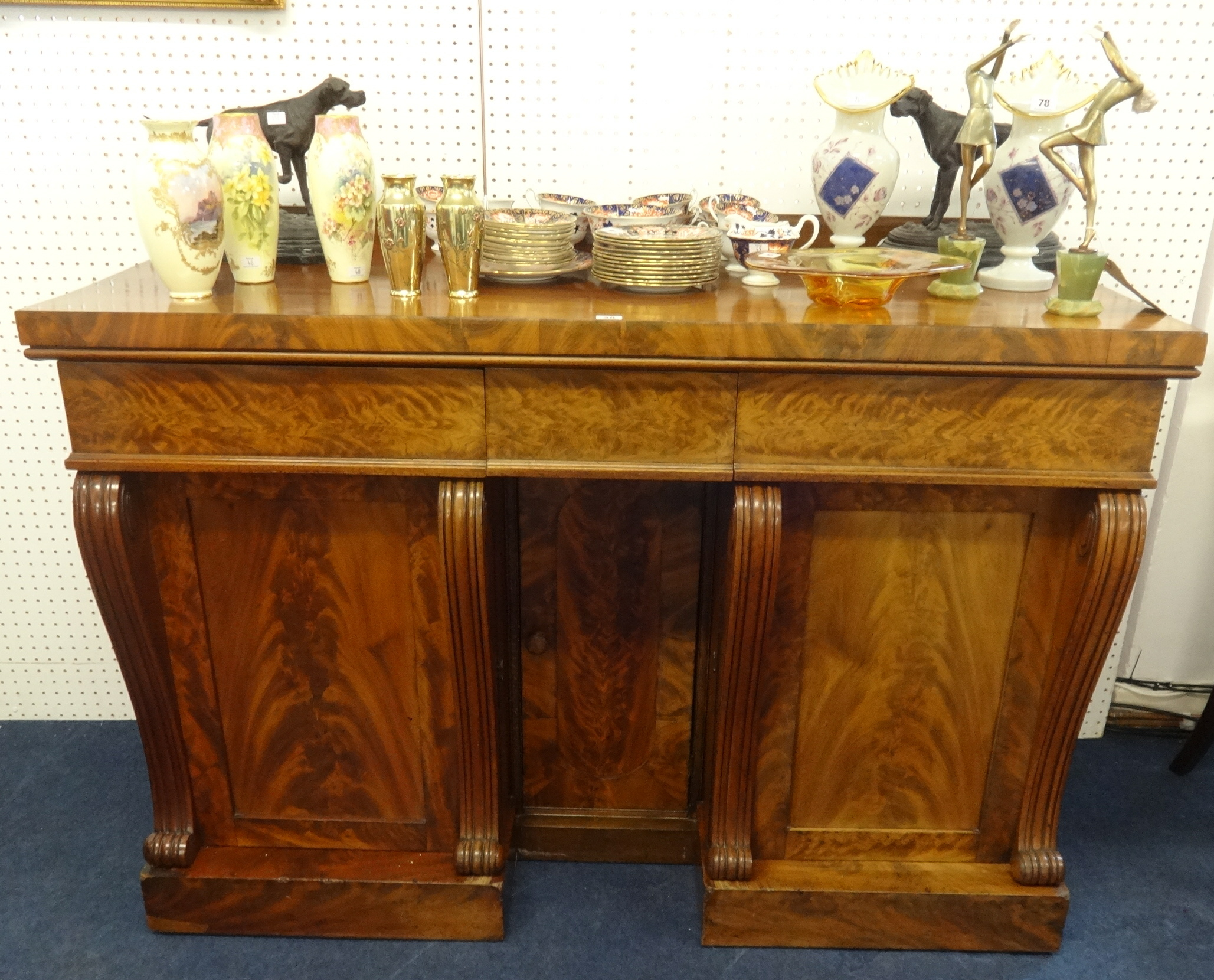 Lot 038 - A Victorian mahogany sideboard with frieze drawers, cupboards and serpentine supports, width