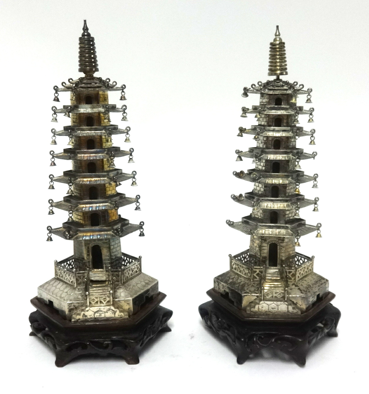 Lot 031 - A pair of Chinese silver Pagoda's possibly by Wang Hing & Company, early 20th century; each composed