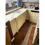Traditional L-shaped cream kitchen Kohler ceramic sink overhead blue painted cupboard photos follow