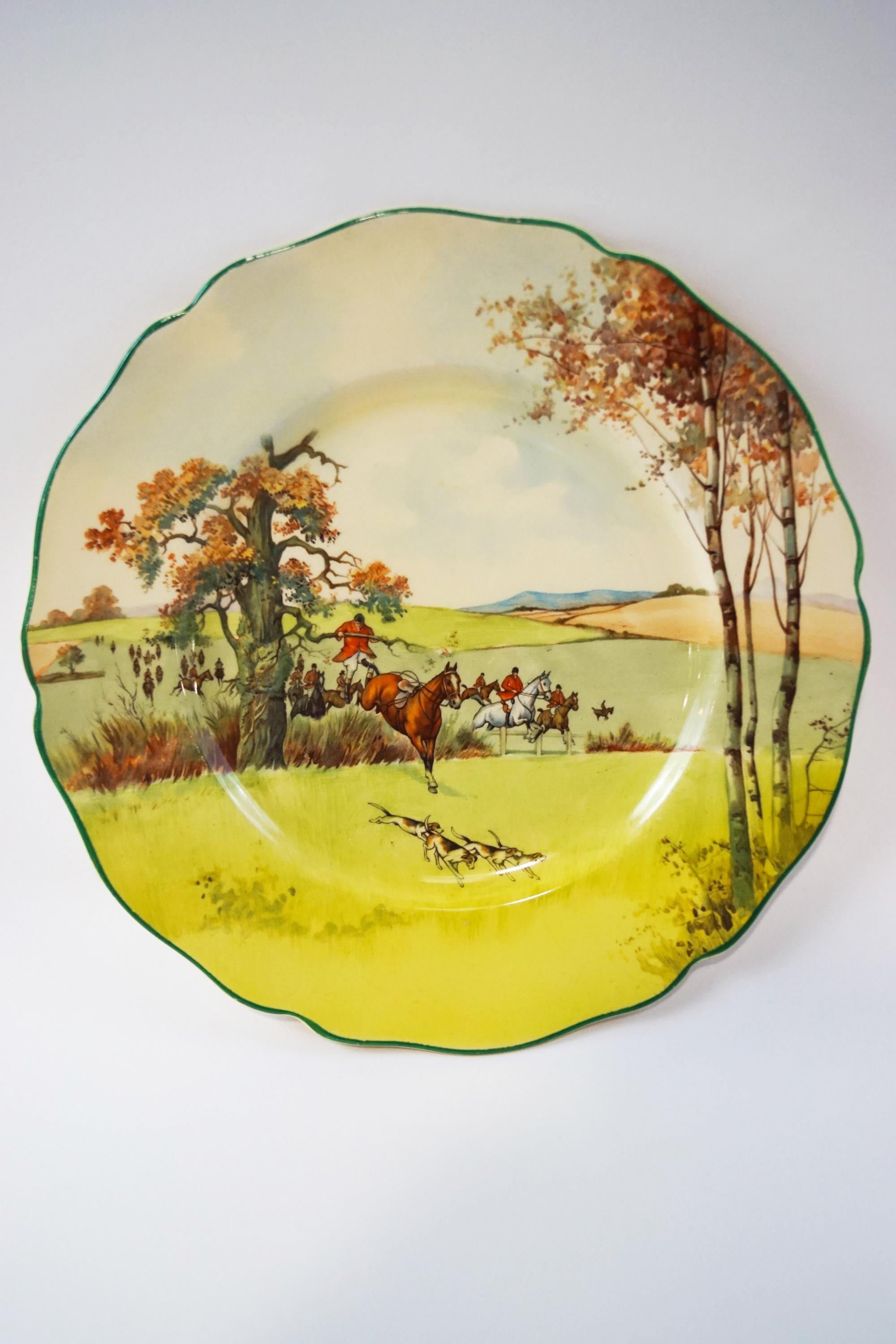 Lot 3 - A Royal Doulton fox hunting scene plate with shaped edge, printed factory marks, 26.