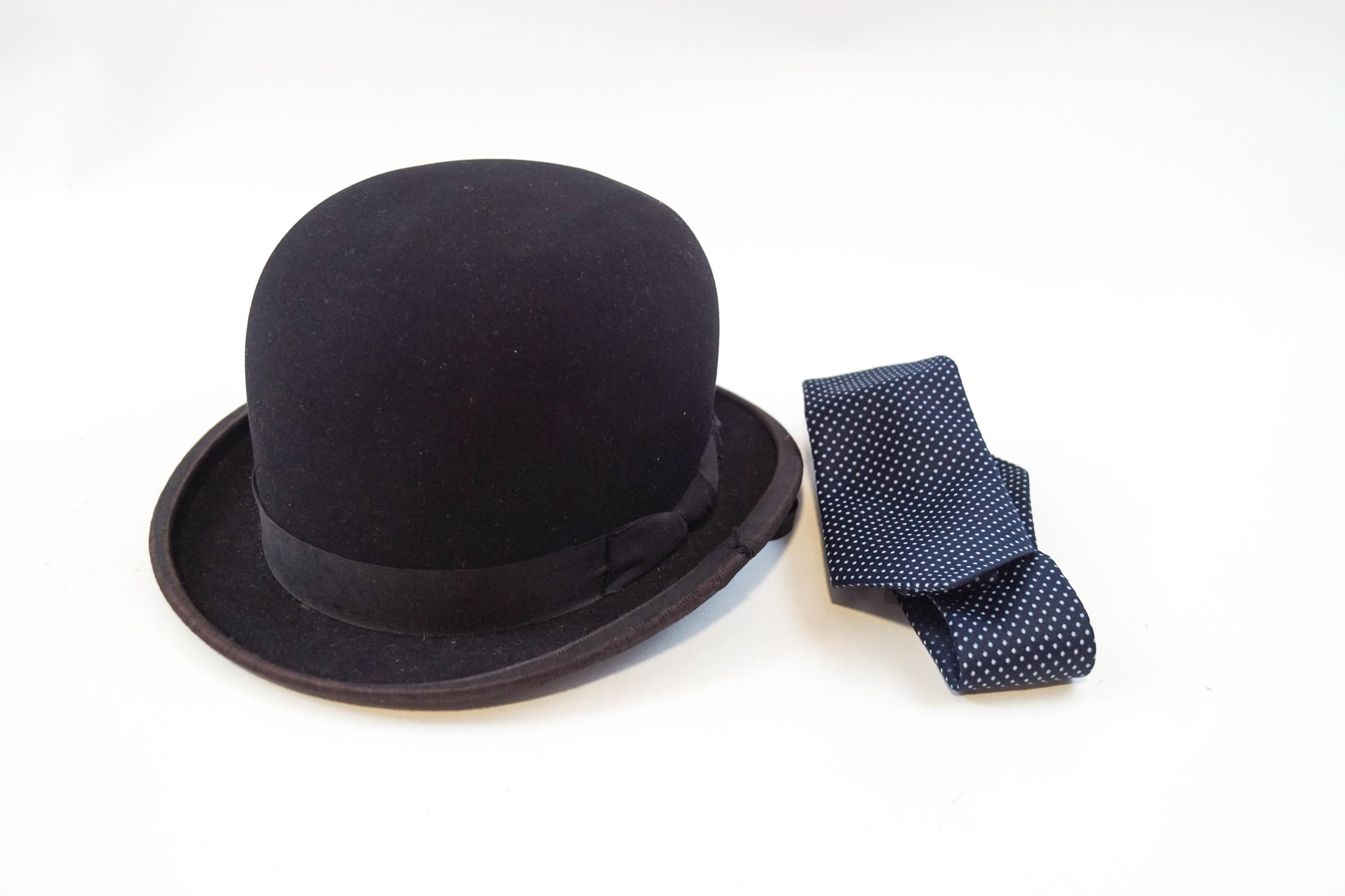 Lot 36 - A child's bowler hat and stock