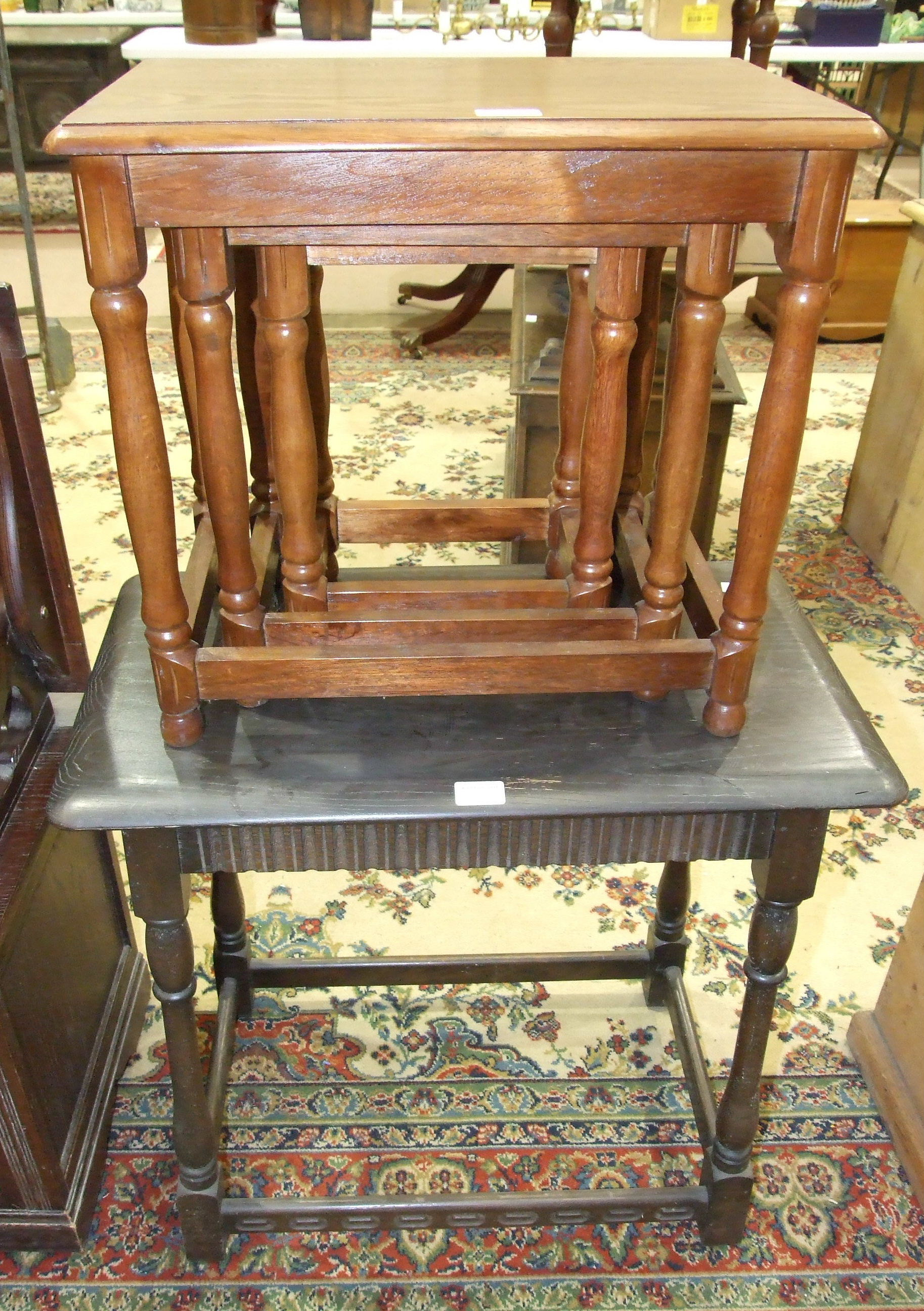 Lot 2 - A modern oak monk's bench, an occasional table and a nest of three tables.