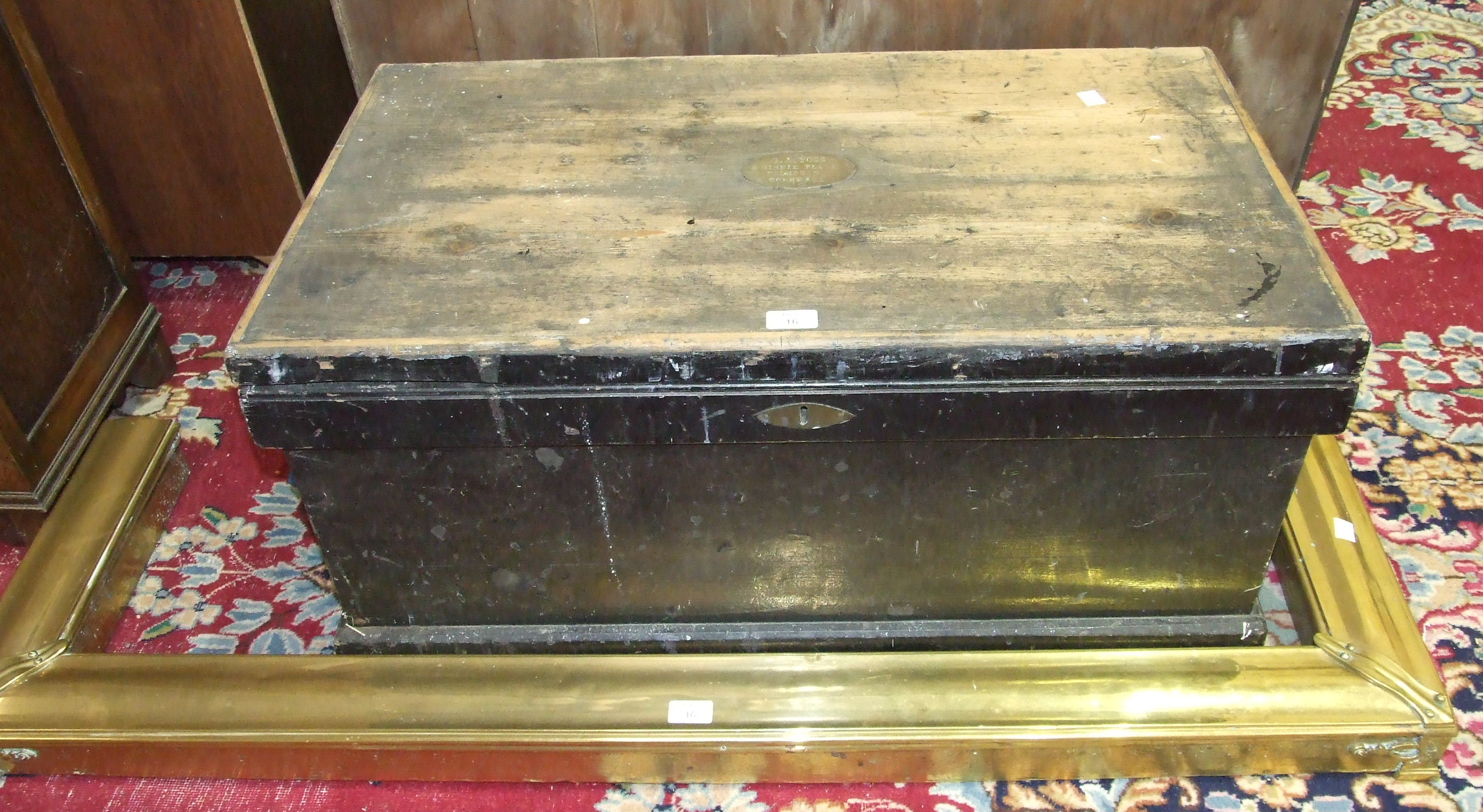 Lot 16 - A stained pine dockyard tool box, 86cm wide and a brass-covered fire kerb, (2).