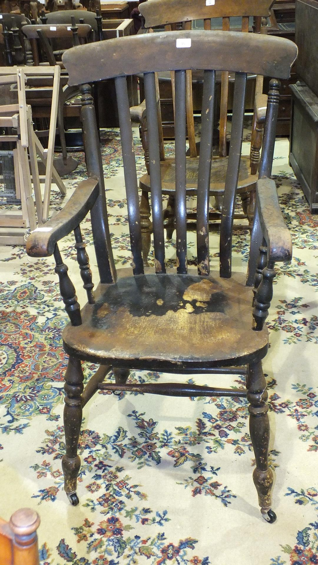 Lot 35 - A stained beech and elm lathe-back farmhouse-style chair on turned legs.