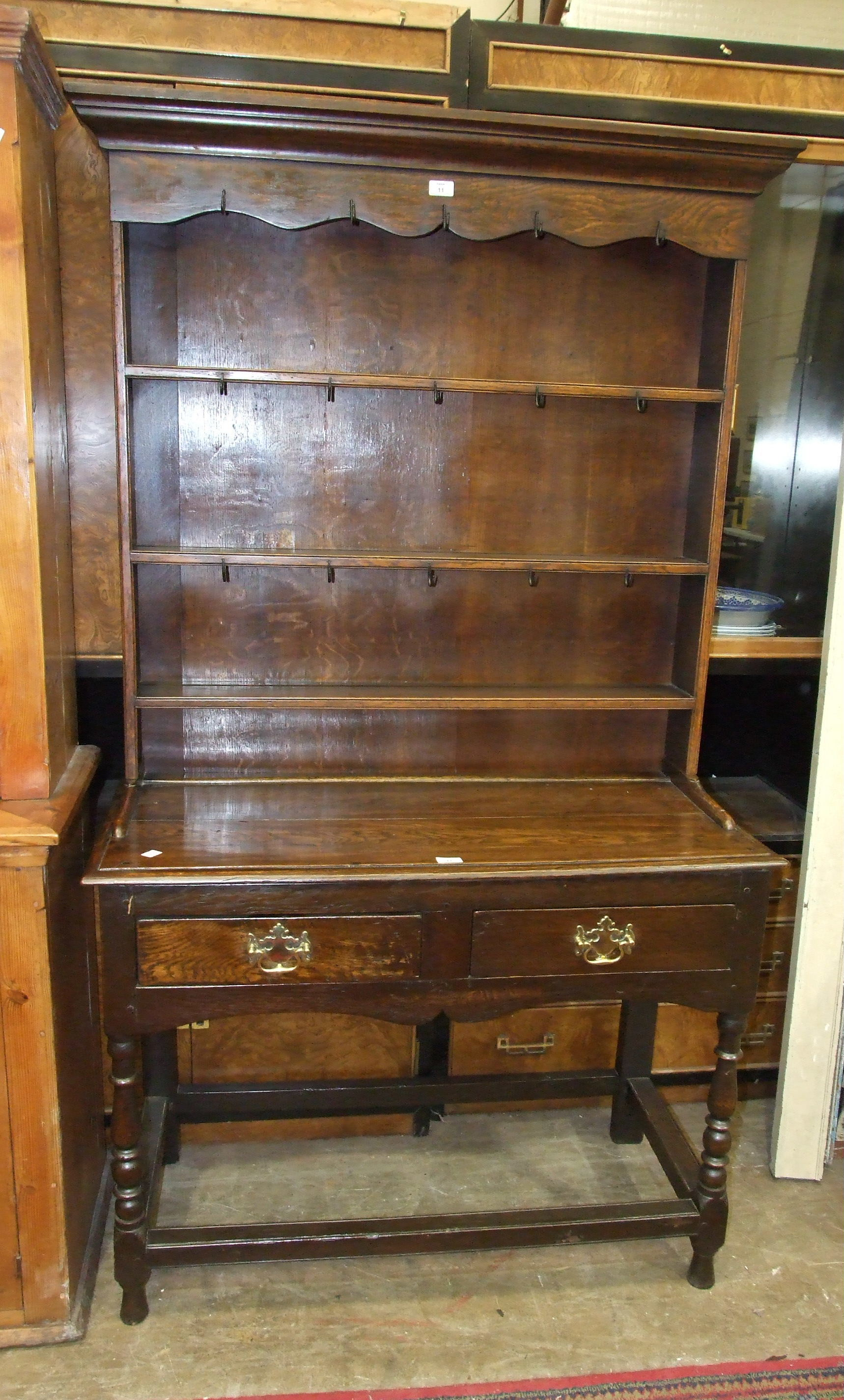 Lot 11 - A reproduction small oak dresser in the 18th century style, the plate rack above two small
