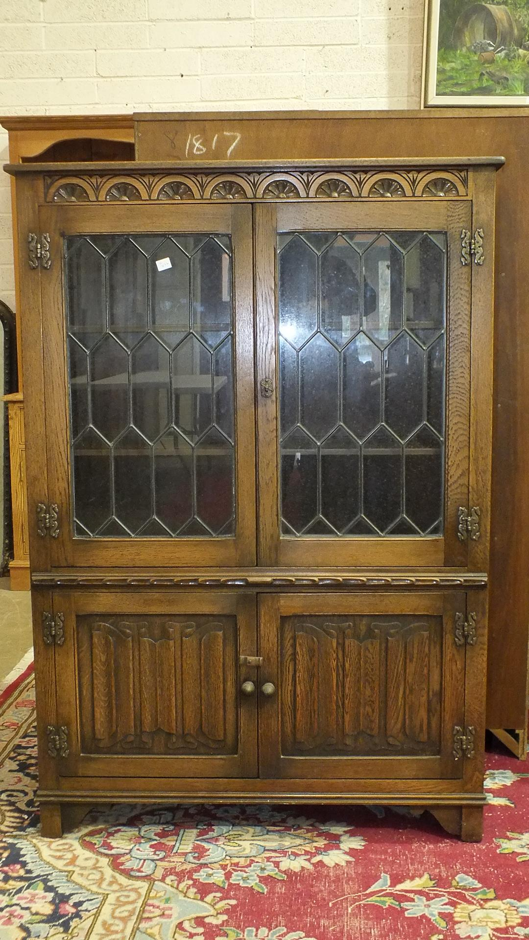 Lot 5 - An 'Old Charm' oak bookcase and another, (2).