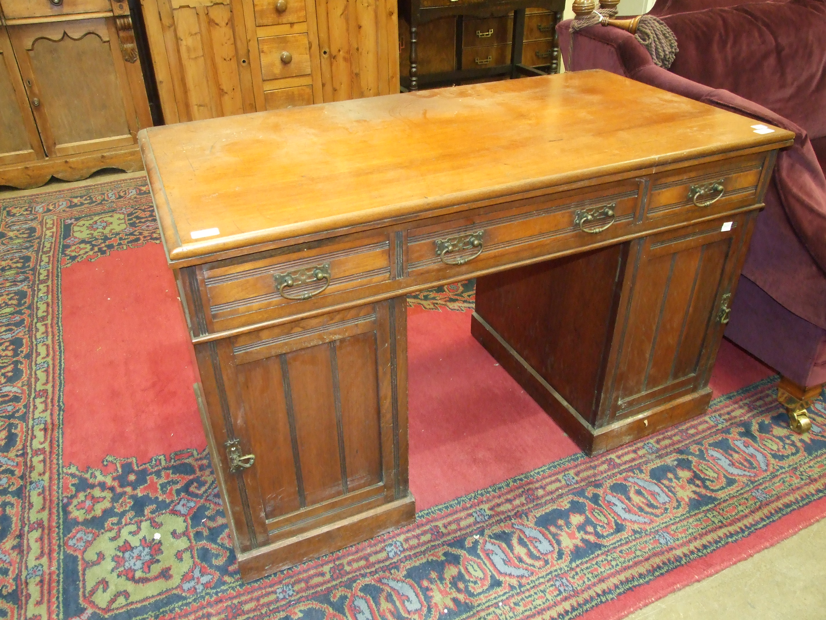Lot 26 - A late-19th/early-20th century mahogany knee-hole desk, the rectangular top fitted with three frieze