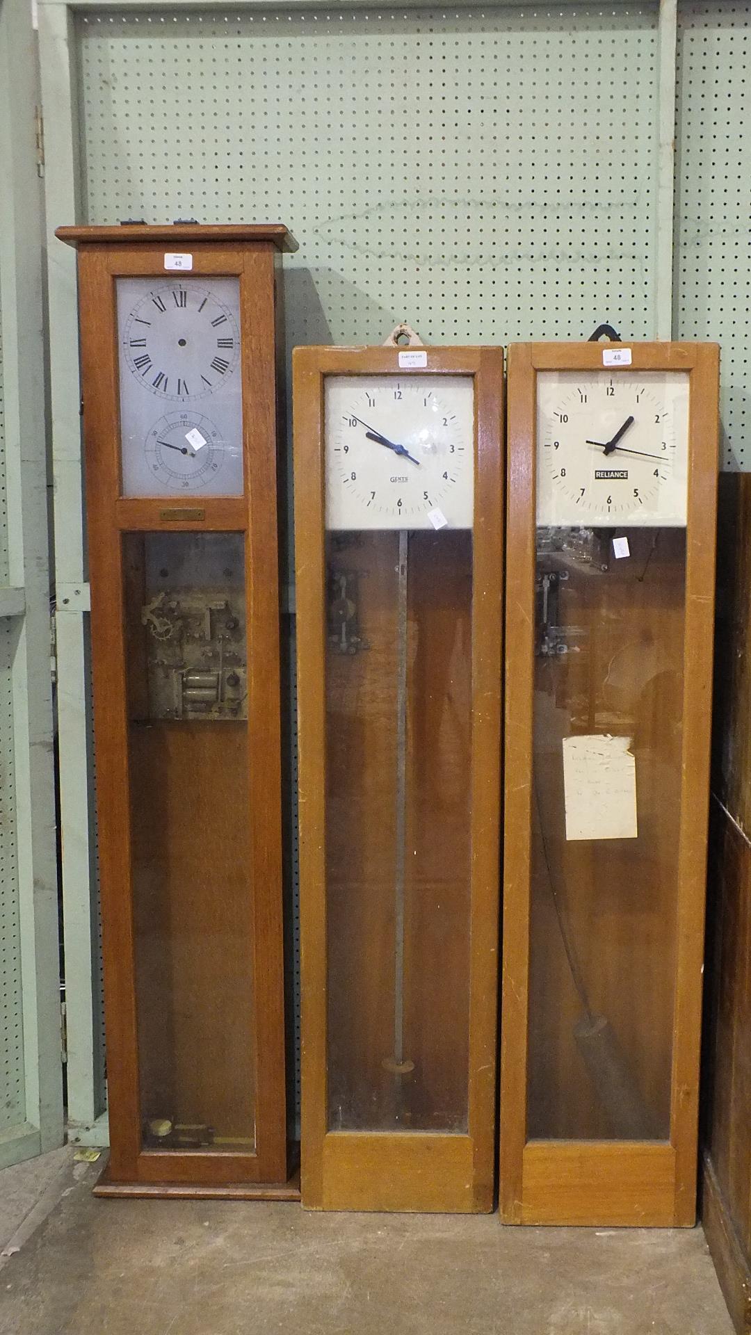 Lot 48 - A Gents electric master clock, 168cm high, a similar electric master clock with 'Reliance' on