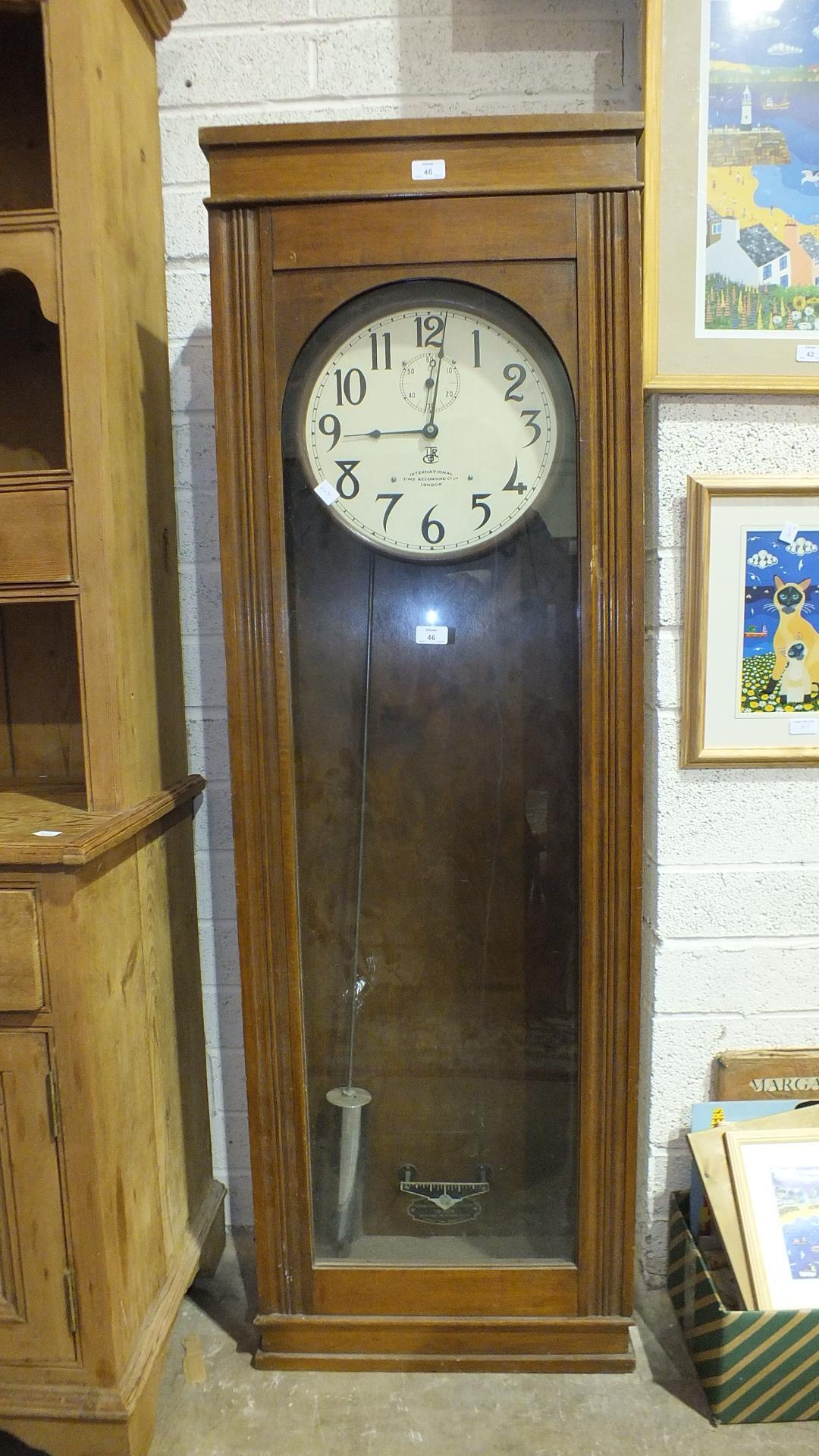 Lot 46 - An International Time Recording Co. Ltd electric master clock with pendulum, 163cm high, model no.