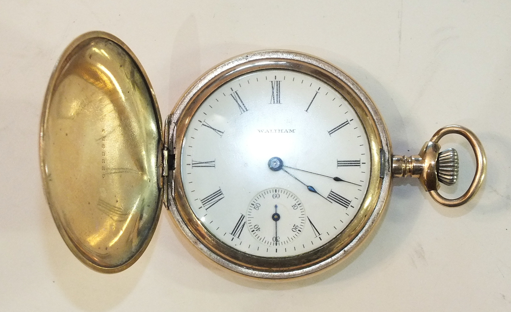 Lot 187 - A gold-plated hunter-cased Waltham pocket watch with white enamel dial, Roman numerals and seconds