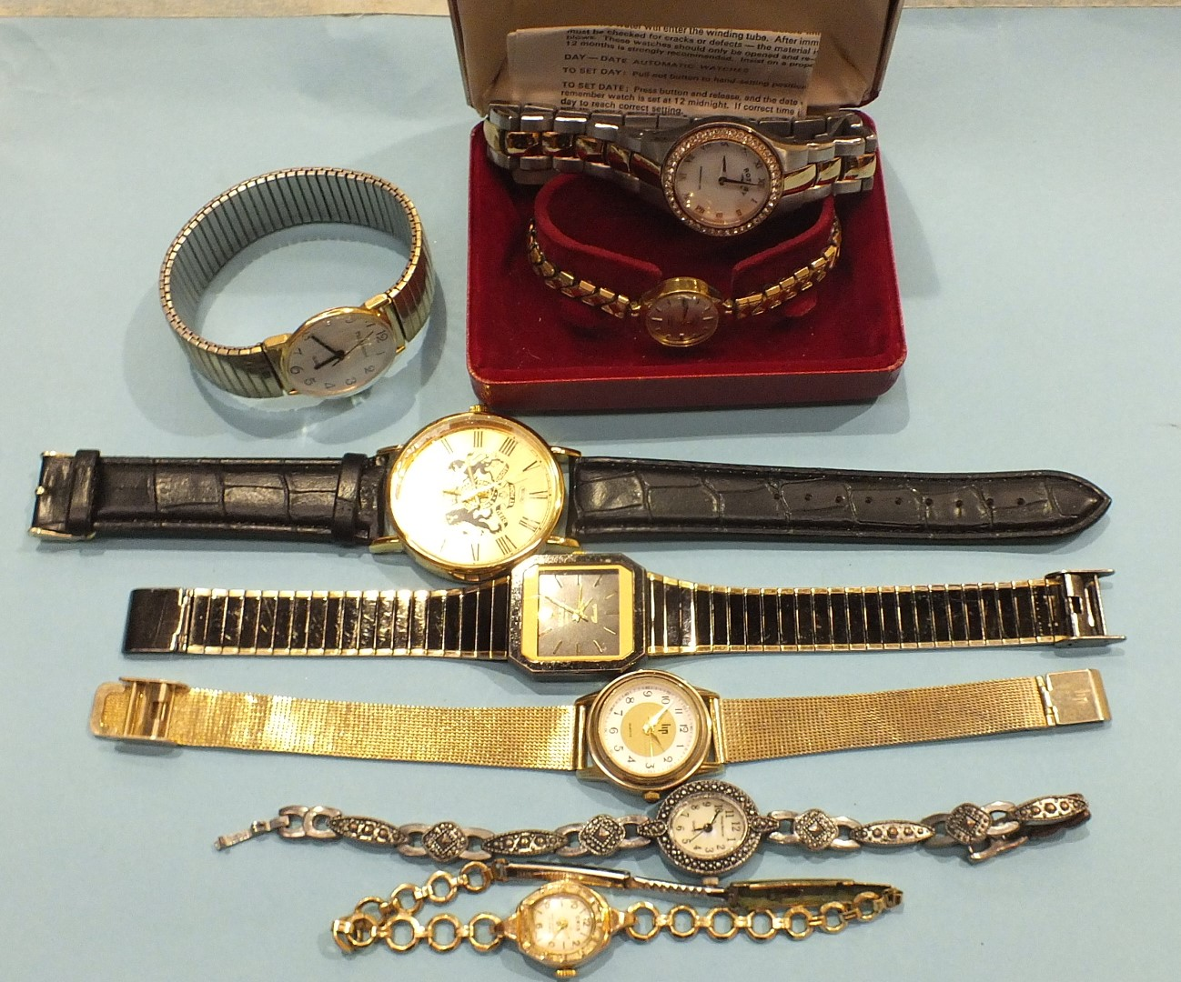 Lot 194 - A ladies 9ct-gold-cased Rotary wrist watch on plated expanding bracelet, boxed, a ladies Rotary