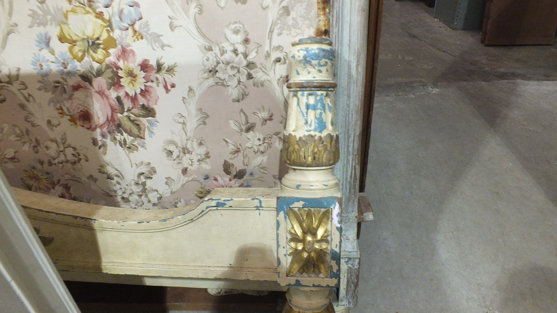Lot 12 - A painted and gilt wood French 6ft bed together with two bedside cupboards, one fitted with a