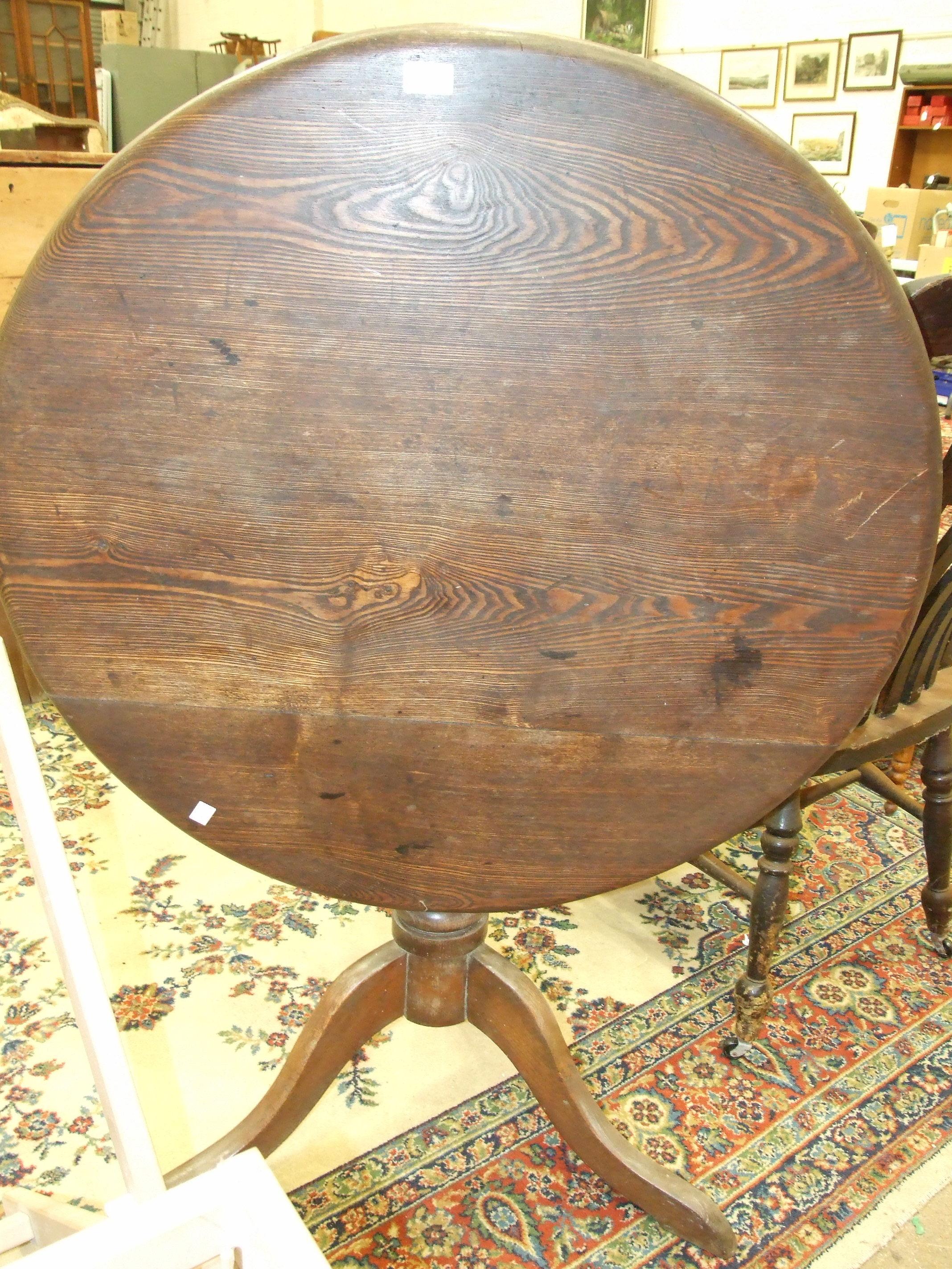 Lot 30 - A 20th century oak monk's bench, 106cm wide, an oak tilt-top circular table on triform support, 88cm