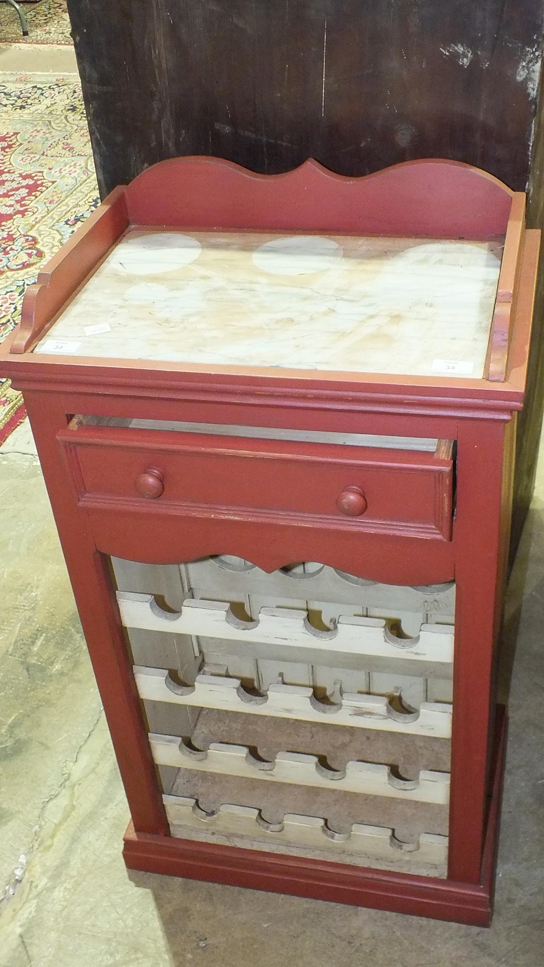 Lot 34 - A modern painted wood wine rack/cabinet, the top with inset marble, above a single drawer, 53cm