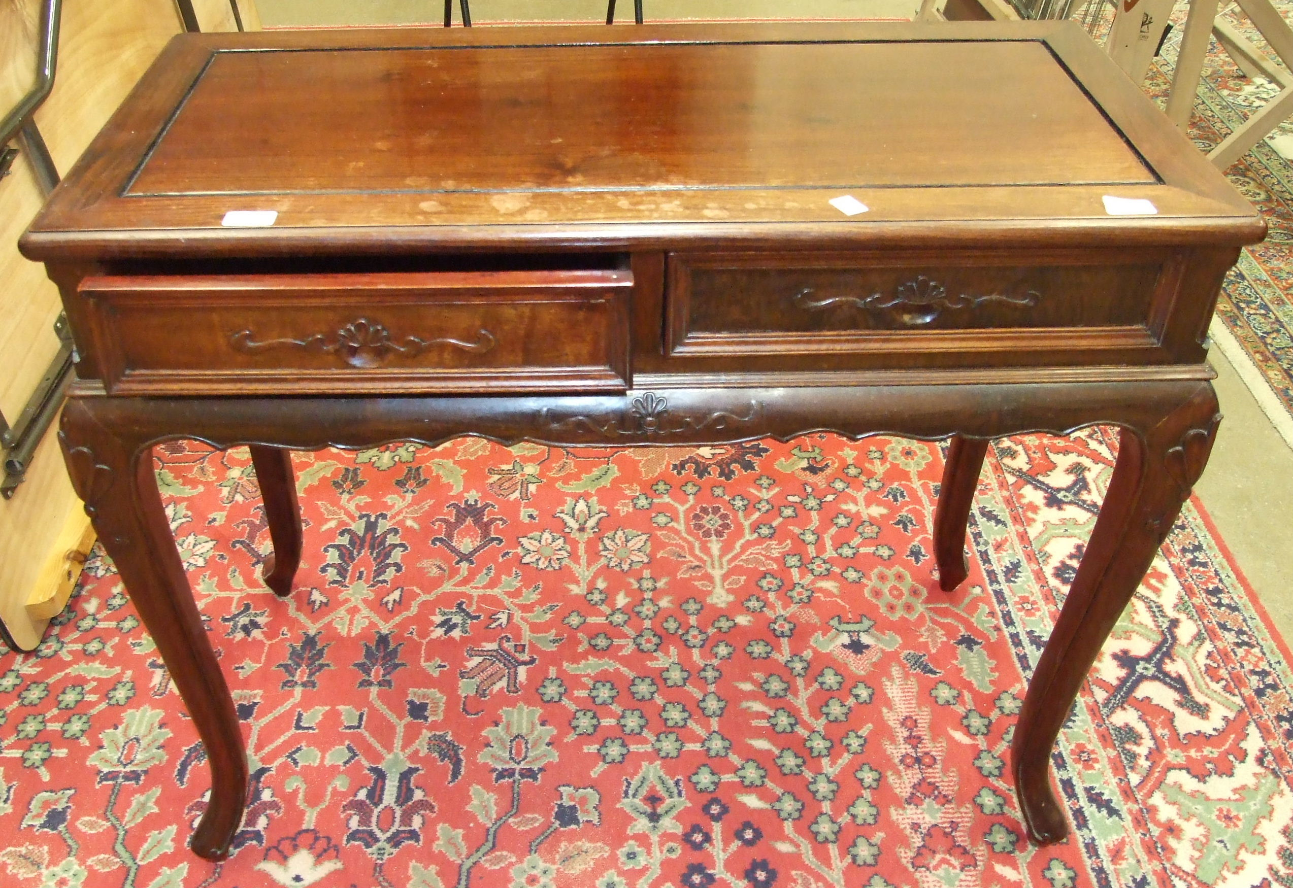 Lot 14 - A modern Oriental rosewood side table having two frieze drawers, 87cm wide.