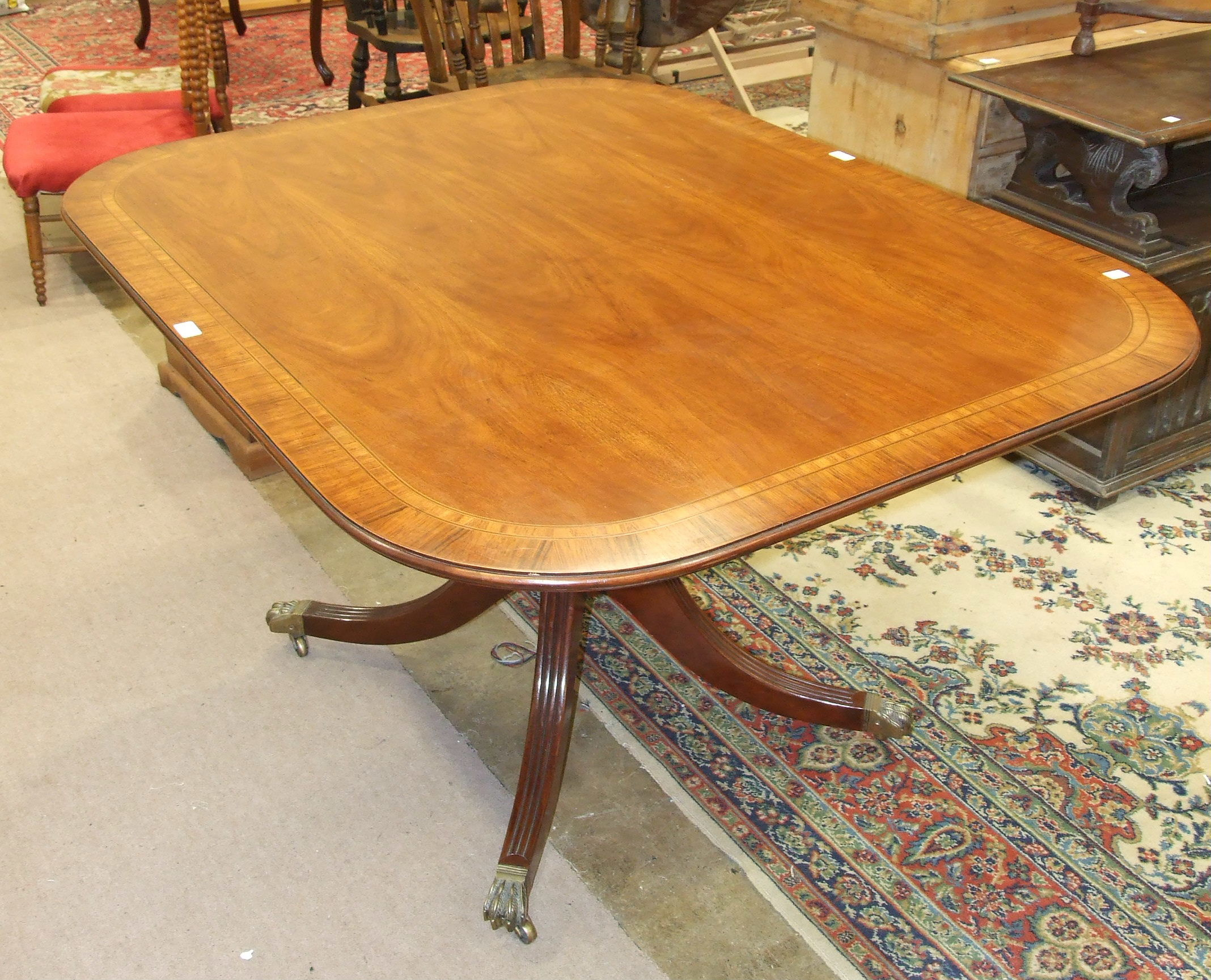 A reproduction breakfast table in the George III taste, 140 x 105cm.