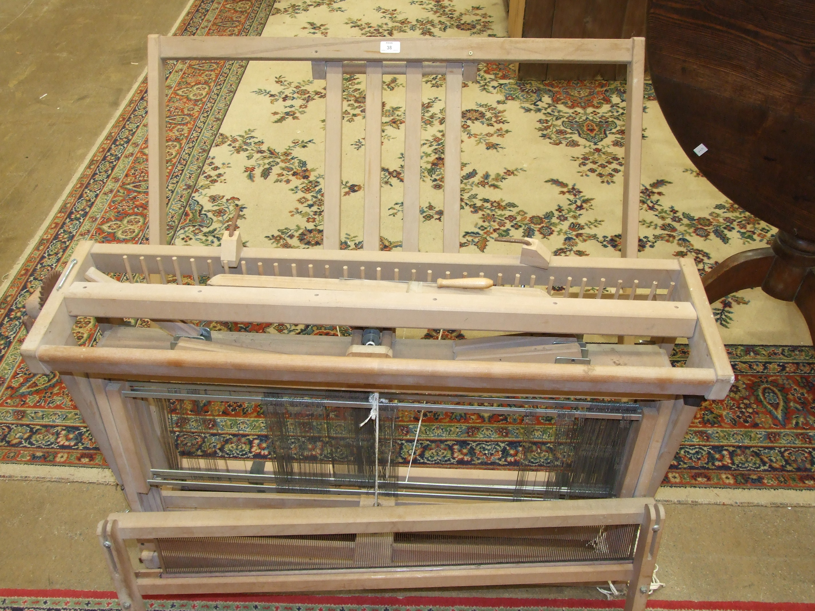Lot 38 - A modern 'Ashford' folding knitting loom, 100cm wide and a small pine needlework box, (2).