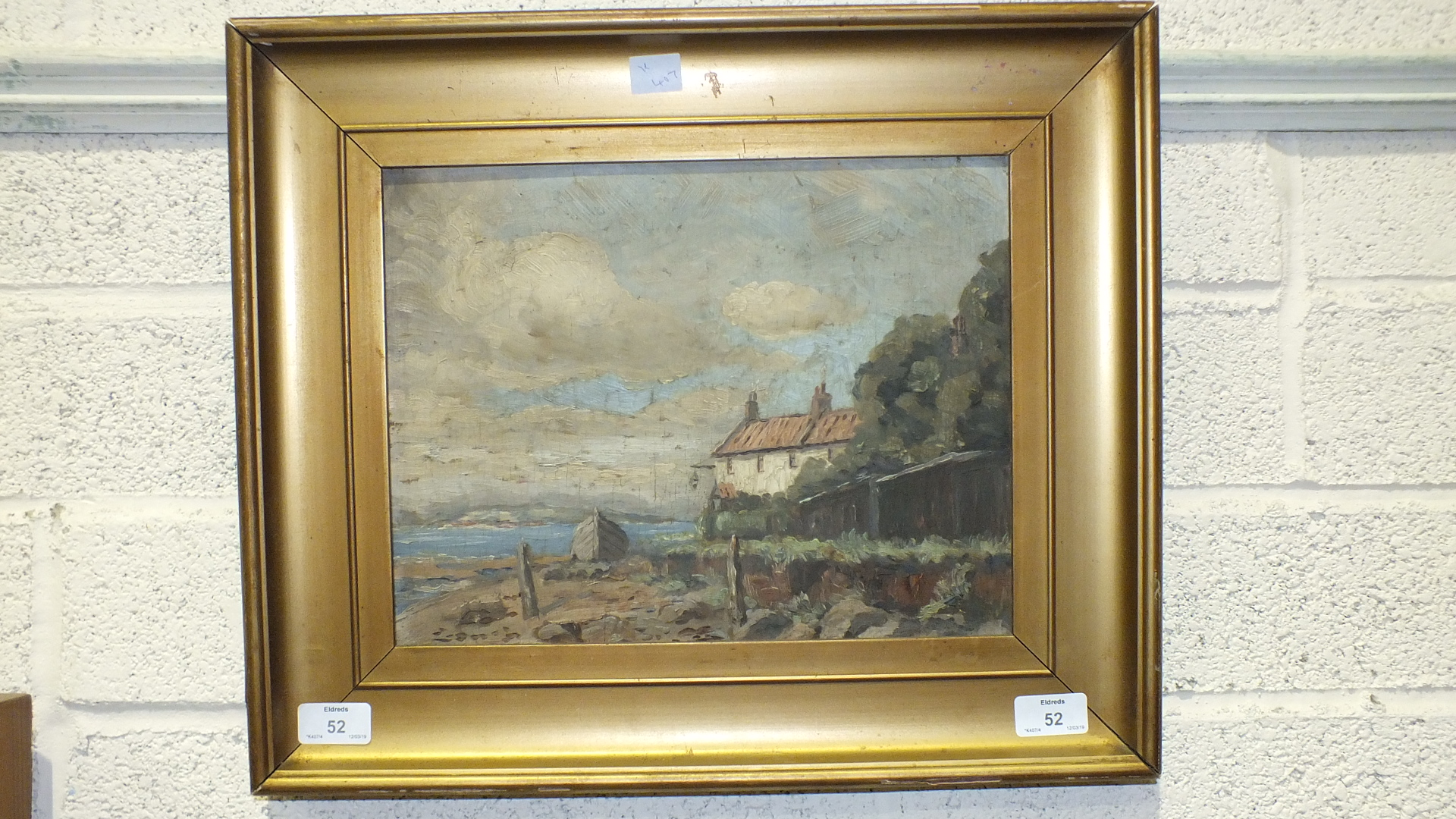 Lot 52 - Unsigned, 'Beached hull beside cottage by the sea', oil on board, 25 x 32cm.
