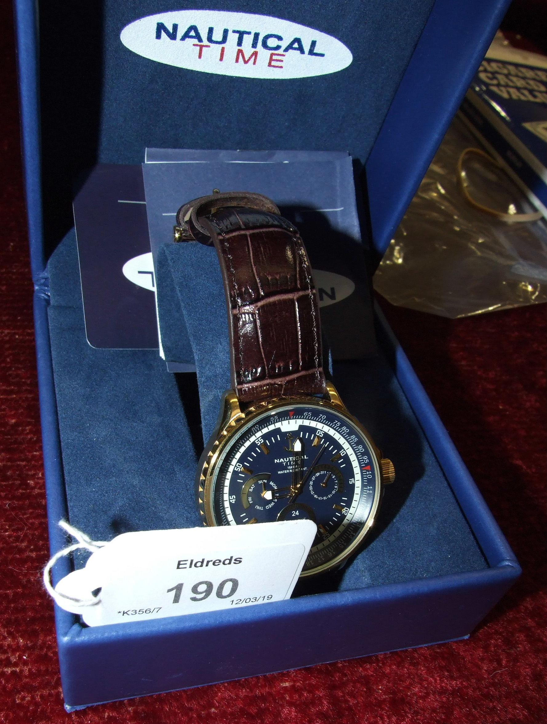 """Lot 190 - A gents Nautica wrist watch, boxed with papers and another, similar, """"Nautical Time"""", (2)."""