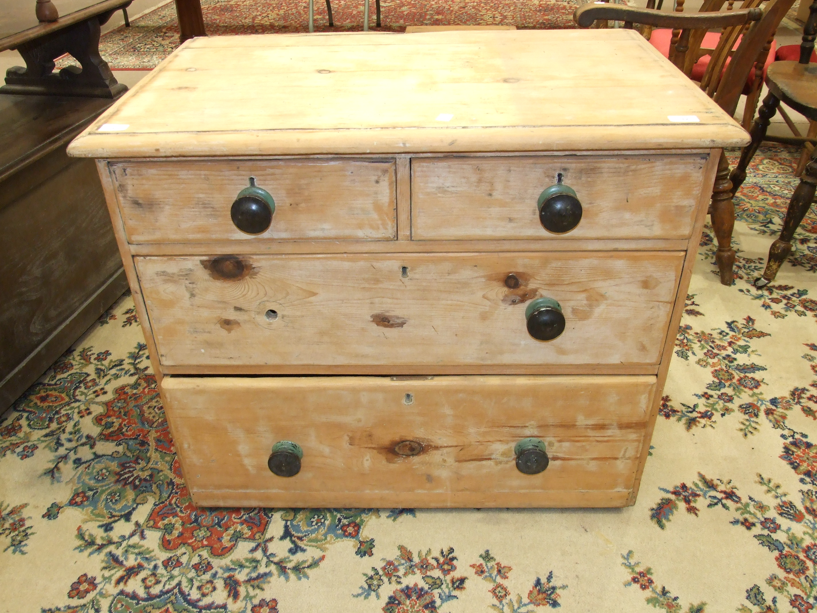 Lot 32 - A stripped pine straight-front chest of two short and two long drawers, 91cm wide, (legs lacking).
