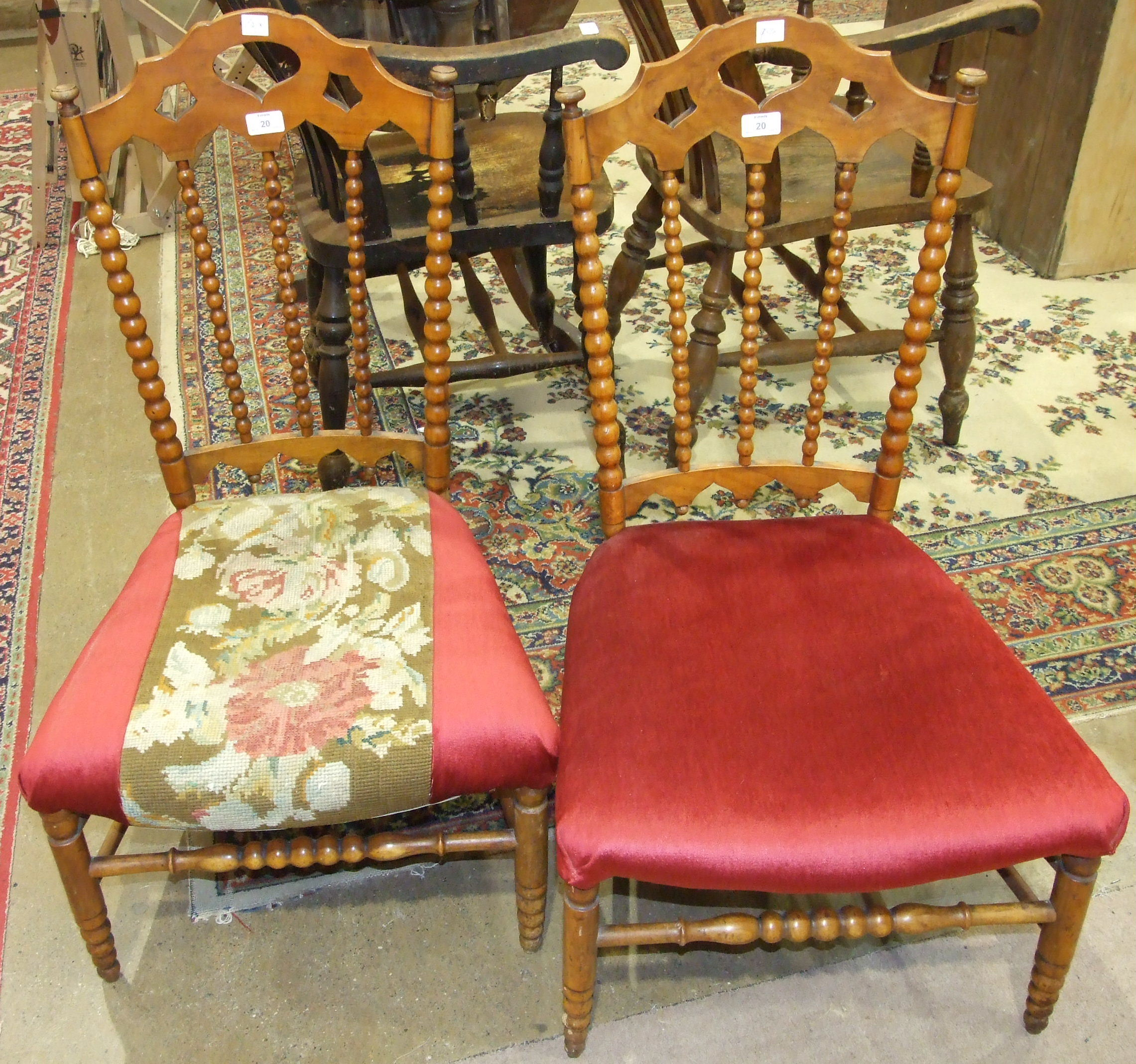 Lot 20 - A pair of 19th century fruit wood bobbin-turned nursing chairs, with open backs and upholstered