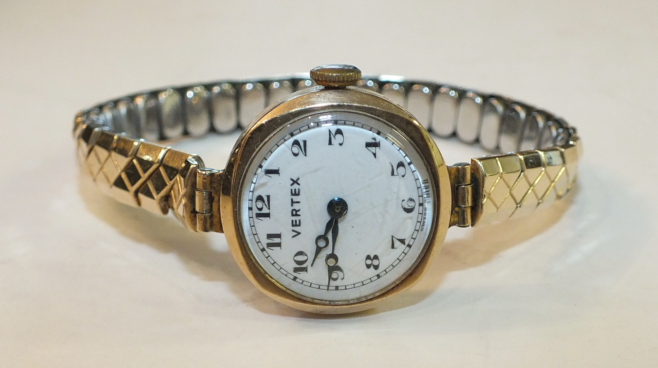 Lot 188 - A ladies 9ct-gold-cased Vertex wrist watch on plated expanding bracelet.