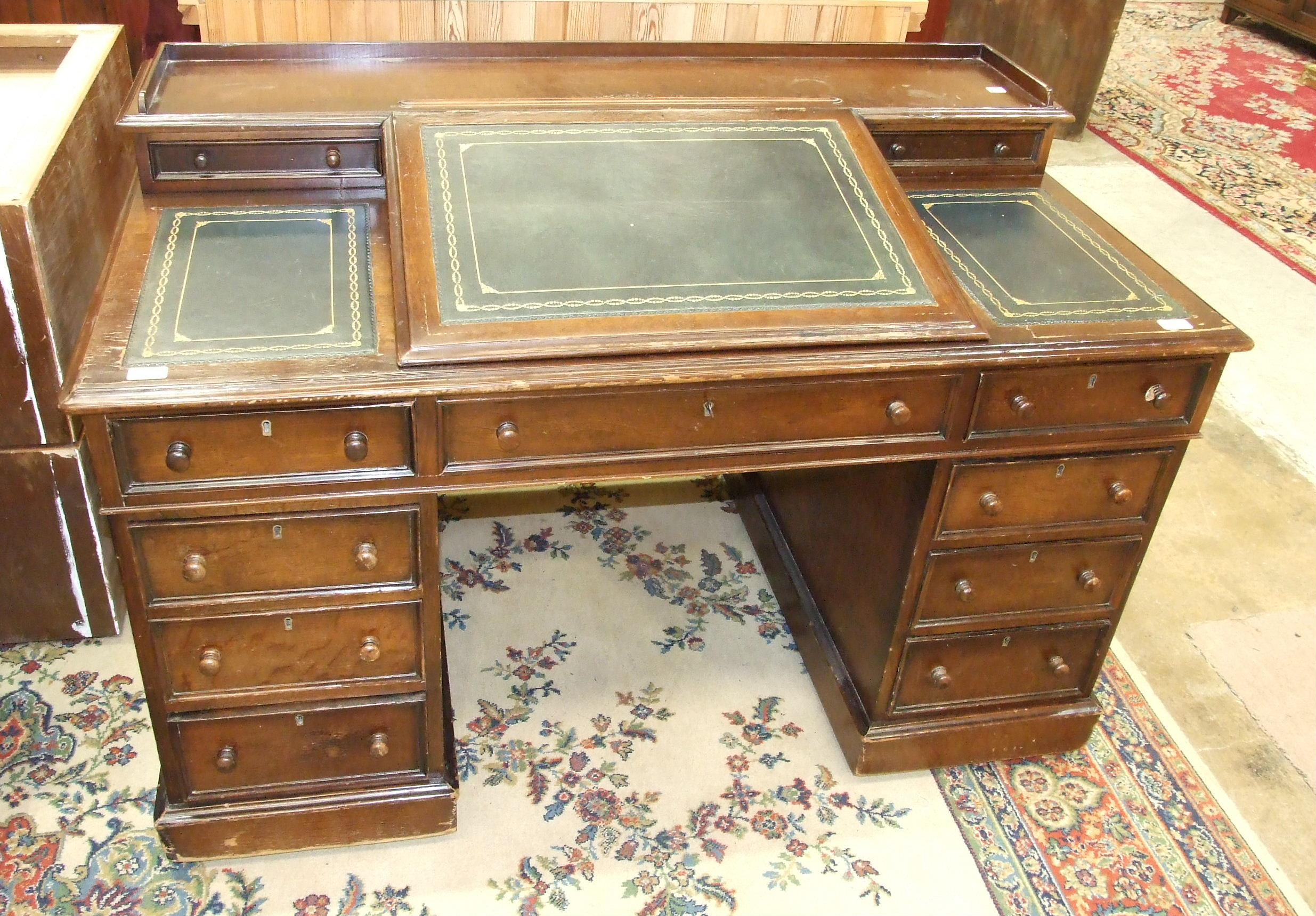 Lot 7 - A 19th Century oak estate desk having two small drawers and central writing slope with fitted