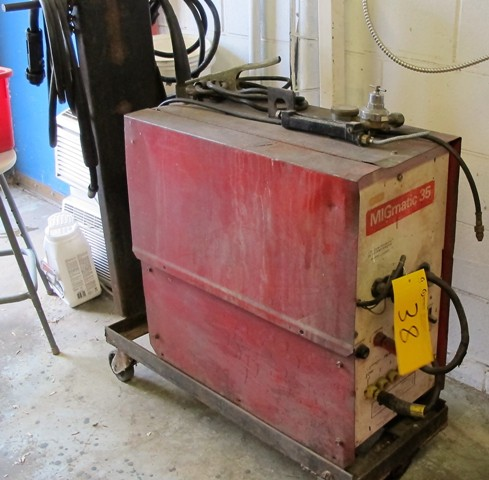 Lot 38 - CANADIAN OXYGEN LTD. MIGMATIC 35 DC WELDER WITH CART, CABLES, WIRE FEED AND GUN