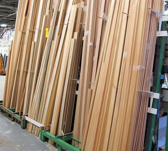 Lot 54 - LOT OF WOOD FINISHING TRIM (UP TO 14'L) W/2 RACKS
