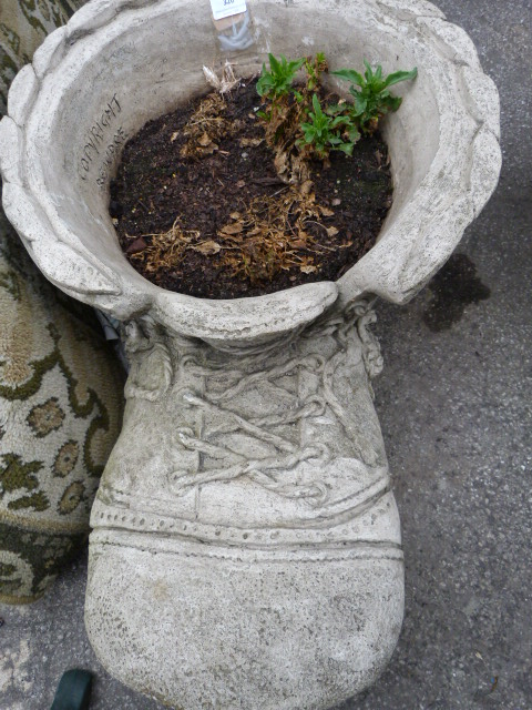 Cast concrete planter in the form of a boot - Casting concrete planters ...
