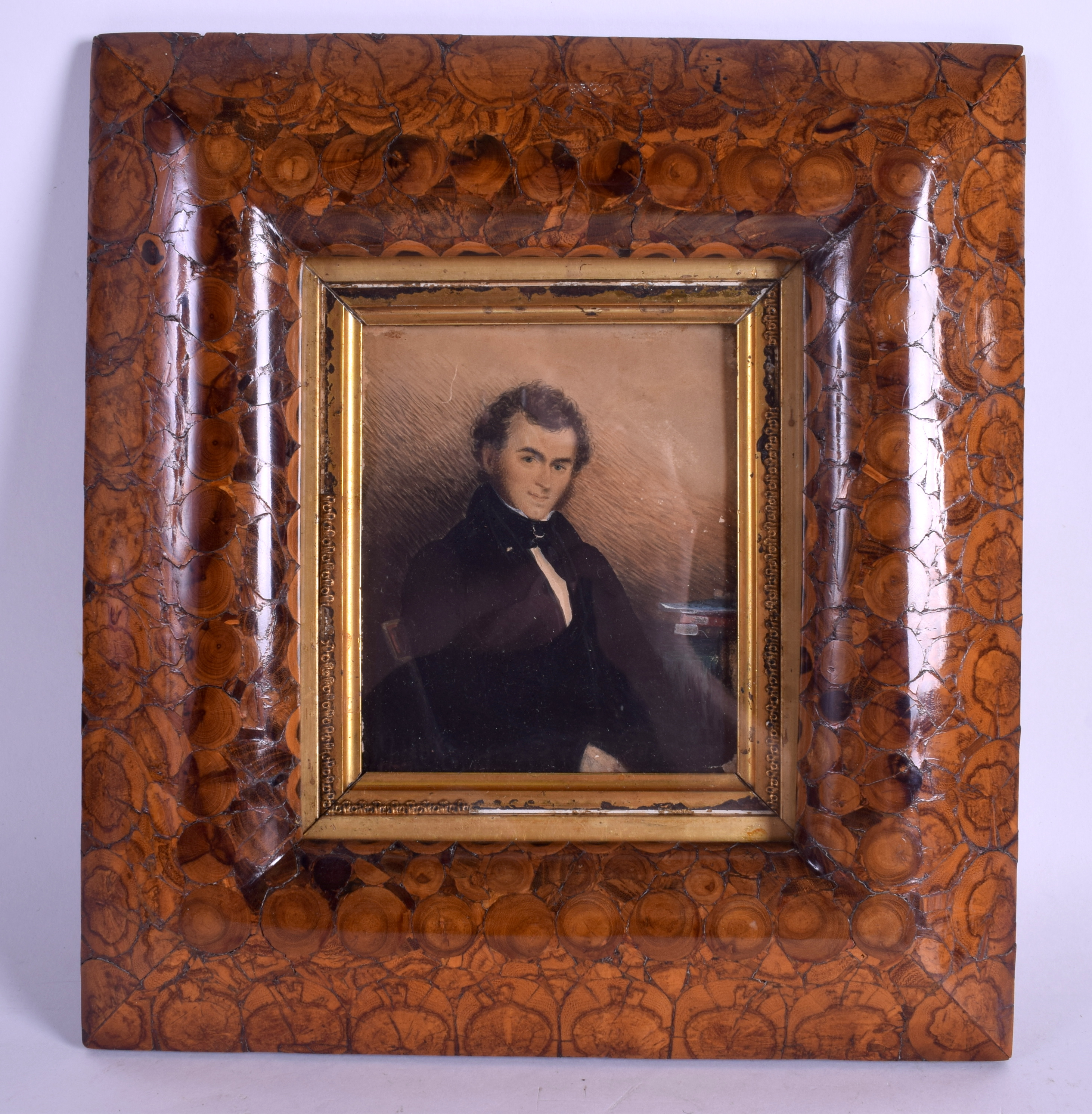 A QUEEN ANNE OYSTER WOOD FRAME containing a late Regency watercolour of a gentleman. Frame 30 cm x