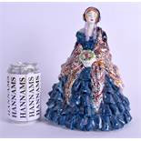 AN UNUSUAL ENGLISH ART POTTERY FIGURE THE PAISLEY SHAWL potted by Shanks. 26 cm high.