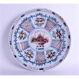 A MID 18TH CENTURY DUTCH DELFT CHARGER C1750 painted with a basket of alternating flowers. 35 cm wi