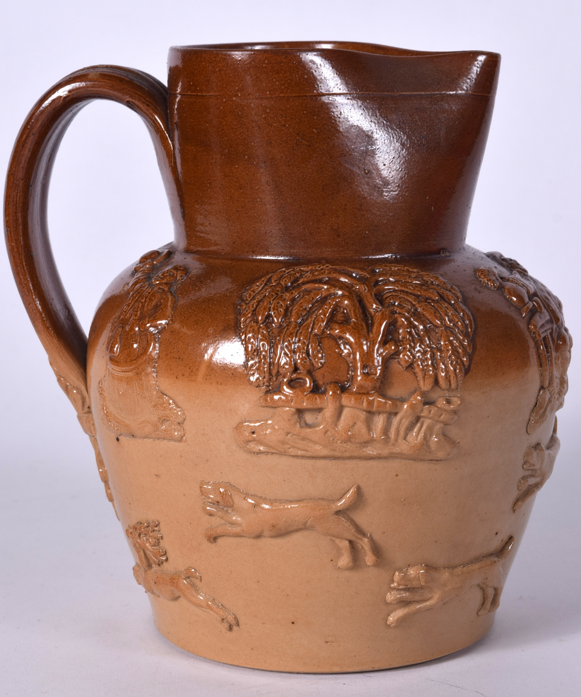 Lot 2497 - A LATE 19TH CENTURY STONEWARE FOX HUNTING JUG, decorated with hunting scenes. 17.5 cm x 17 cm.
