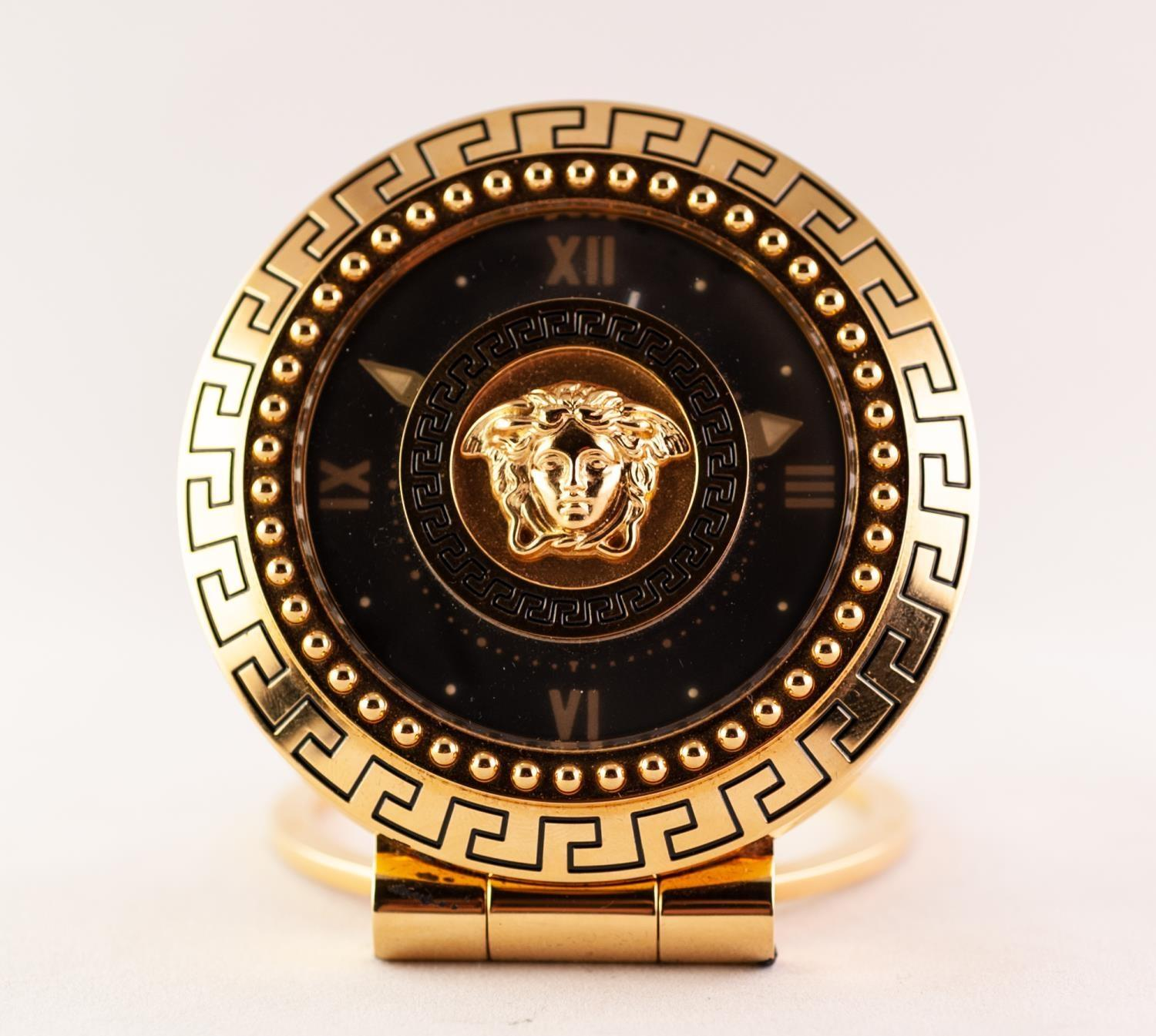 Lot 37 - A GIANNI VERSACE TRAVEL/DESK CLOCK The circular black dial with Roman numeral quarter markers,