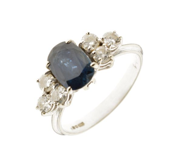 Lot 53 - Sapphire and diamond seven stone 18ct white gold ring, the oval cut sapphire approximately 7.9mm x