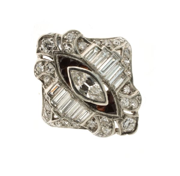 Lot 41 - American diamond and calibré onyx ring, stamped '10% IRI', the central marquise cut diamond