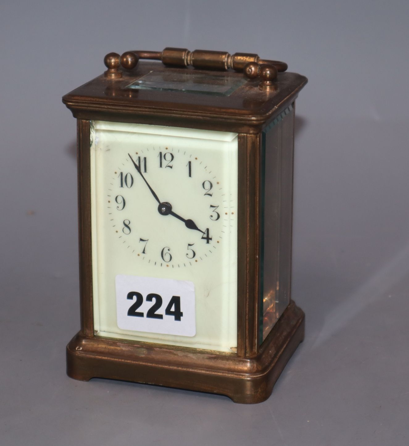 Lot 224 - A brass carriage timepiece with enamel dial