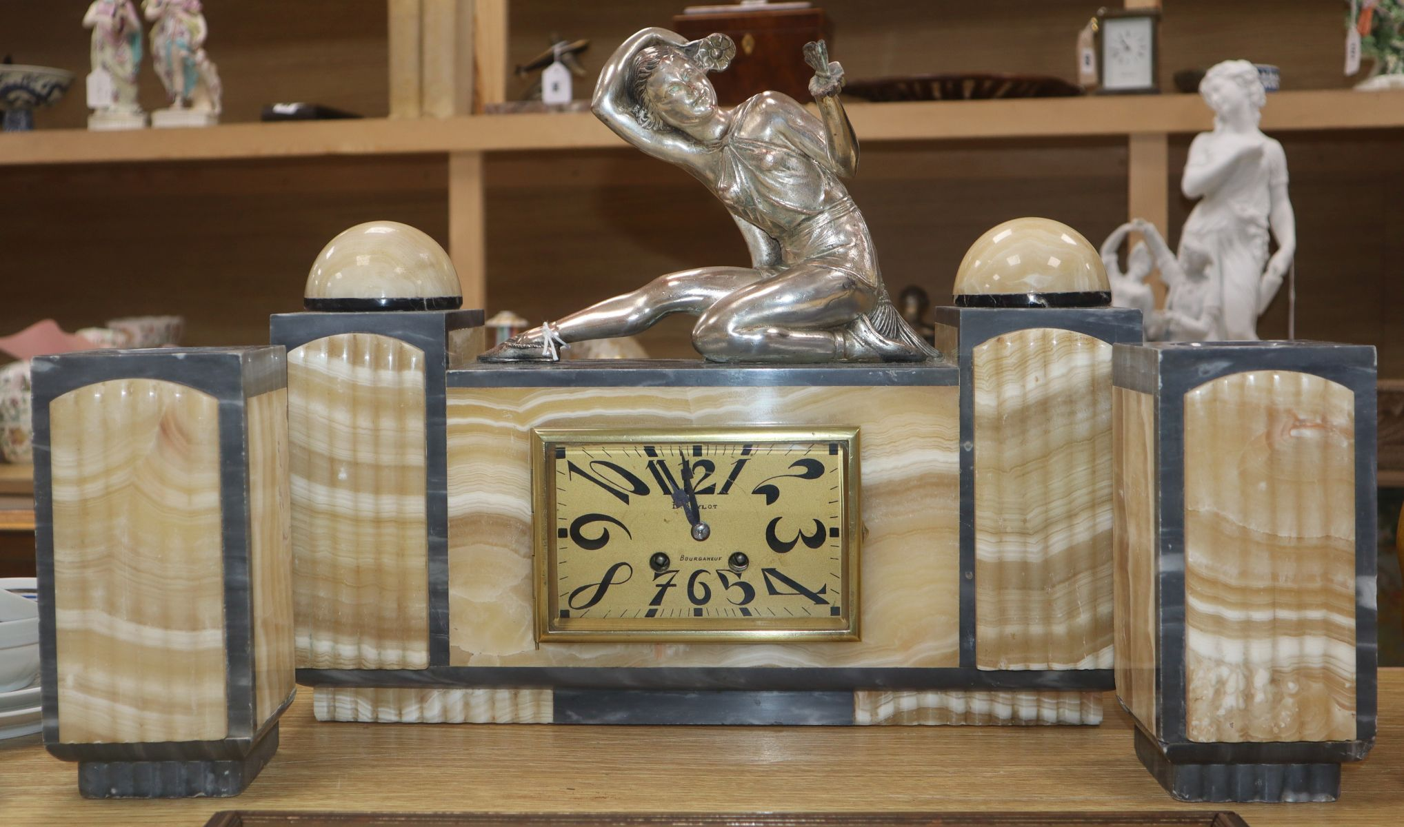 Lot 56 - An Art Deco grey and cream marble clock garniture, with figural surmount height 34.5cm