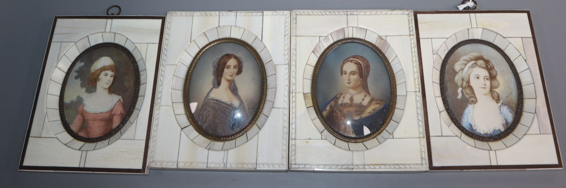 Lot 364 - A set of four miniature portraits on ivory