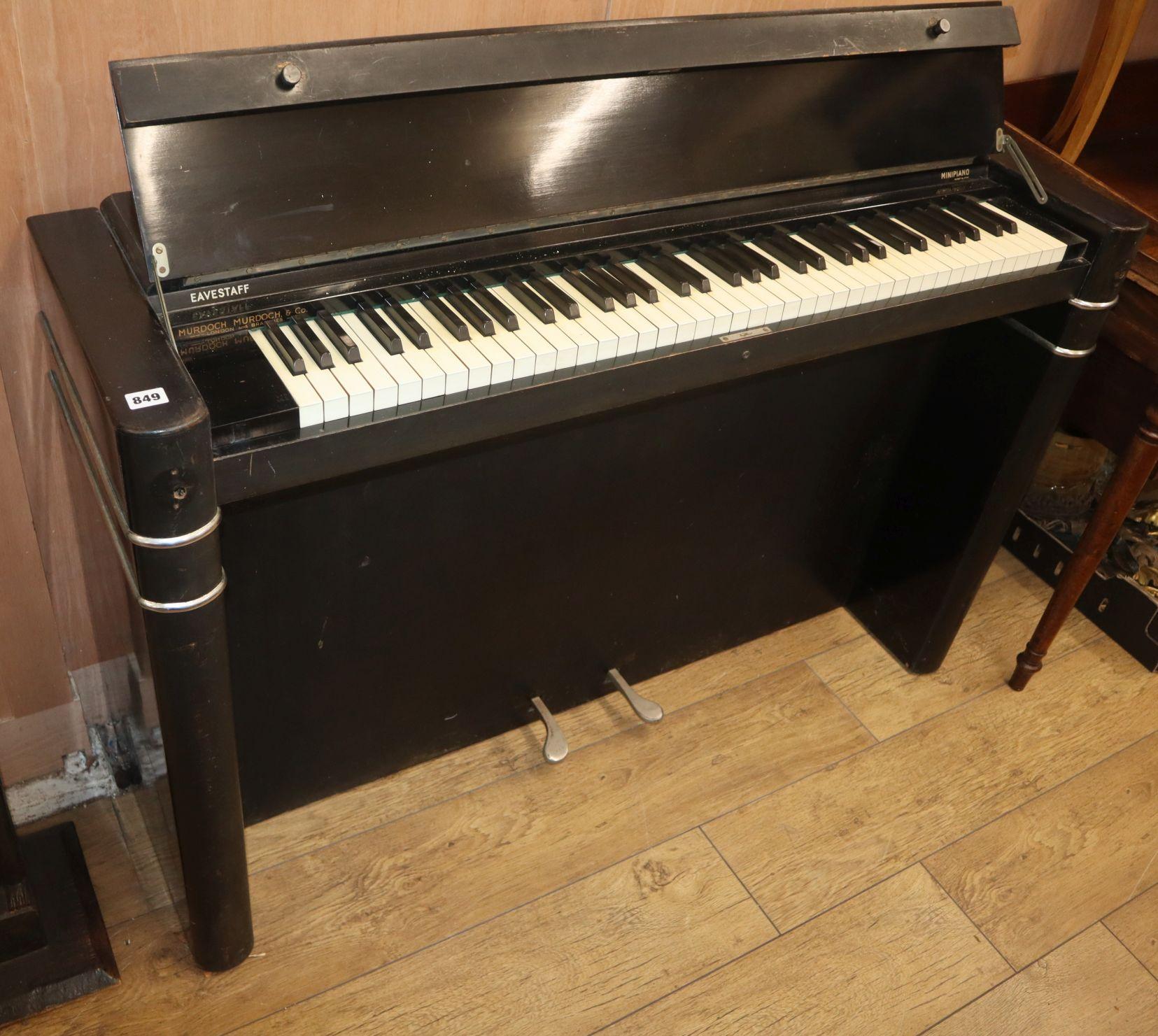 Lot 849 - An Art Deco style ebonised Eavestaff mini piano W.130cm